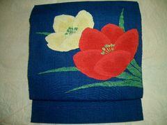 紅白花紋様の紬の名古屋帯