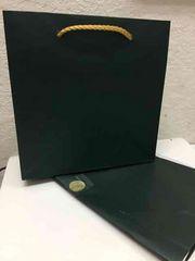 ロレックス 正規 紙袋 シール 包装紙