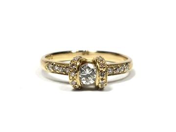 新品同様ノンブランドK18指輪0.50ct12号デザインリンク