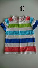 白に赤、青、黄緑ボーダーの半袖Tシャツ