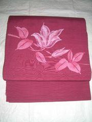 赤紫色水芭蕉紋様紬の八寸名古屋帯