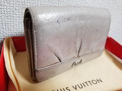 鑑定済み。COACH。二つ折りL字財布